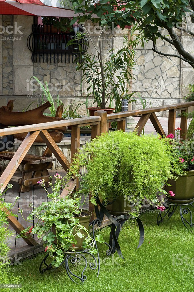 open air cafe with lots of green plants royalty-free stock photo