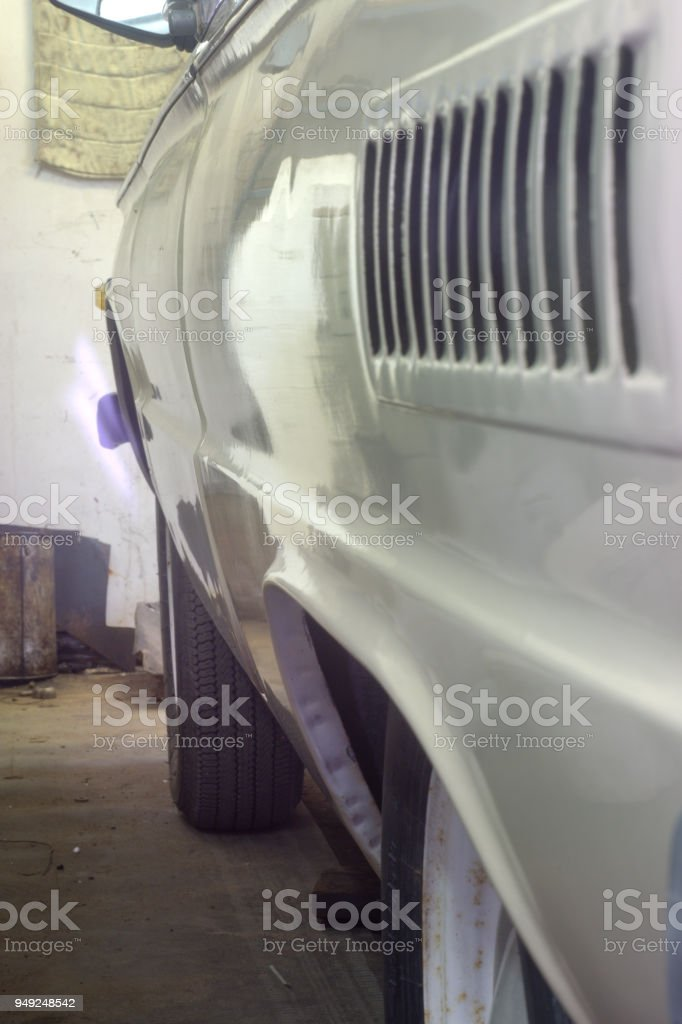 open air intake of an old car. Side grille of the outlet air intake, located at the rear. The cooling element of the engine. In garage stock photo
