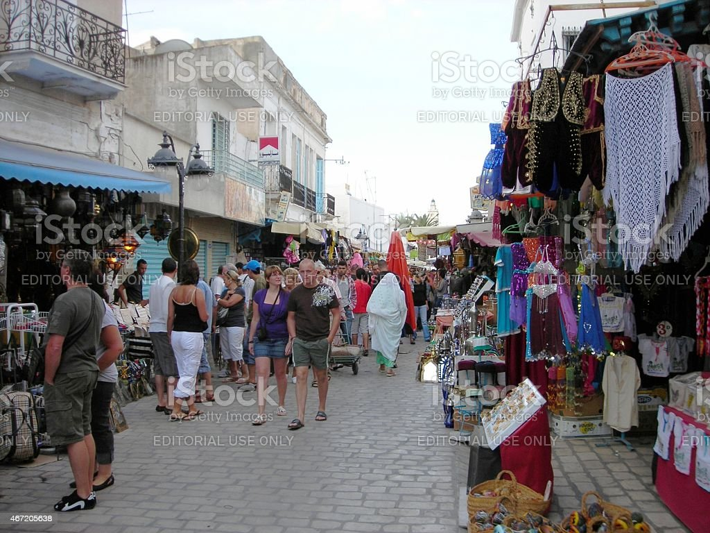 Tourists and locals at the open-air market in the Tunisian seaside...