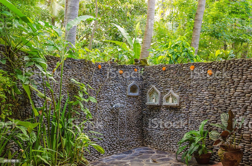 open air shower with palms in jungle in Bali Indonesia stock photo