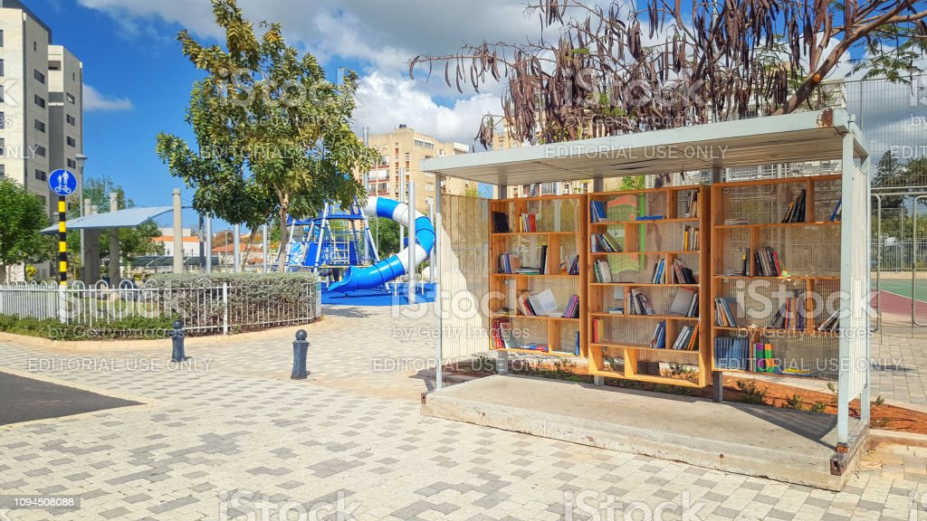 Open air voluntary book library in the neighborhood stock photo