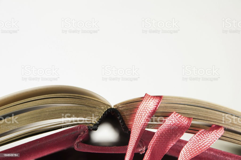 open antique red book with golden paper stock photo