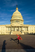 Woman enjoy sunrise in front of Capitol Building, Washington DC, USA