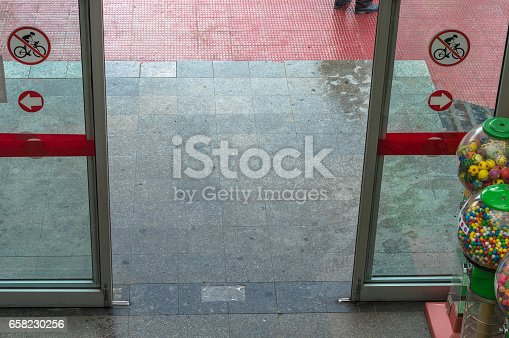 istock Open automatic door at the entrance of a shopping mall 658230256