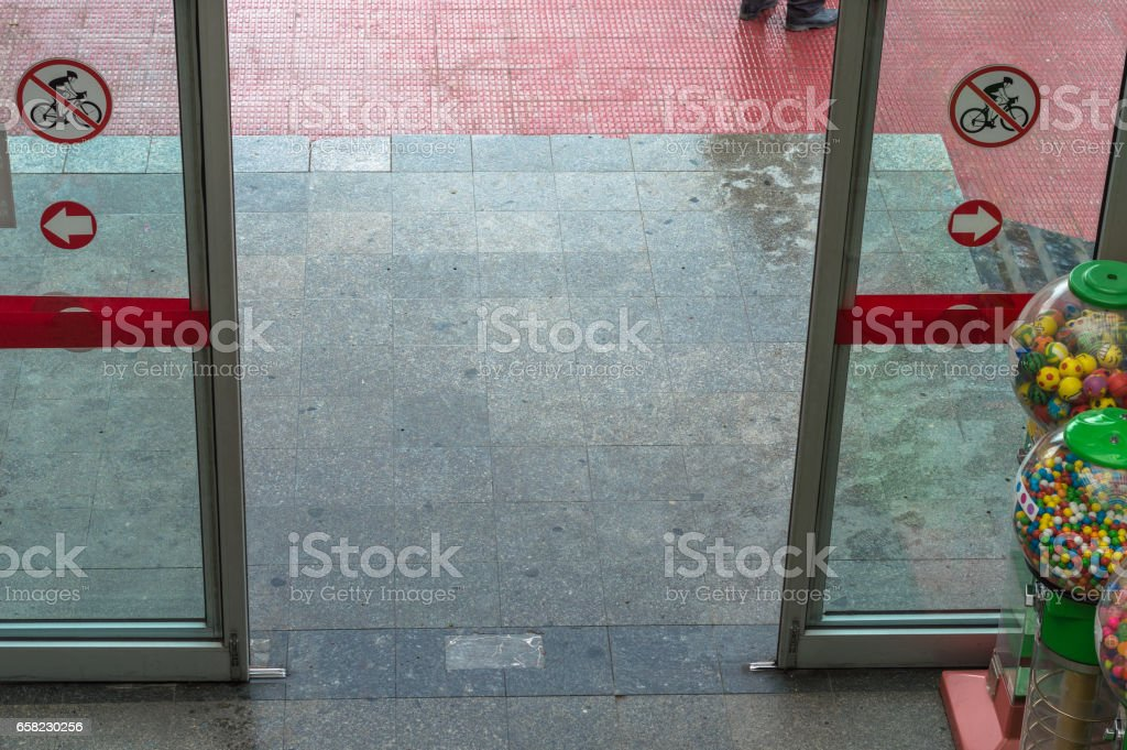Open automatic door at the entrance of a shopping mall stock photo
