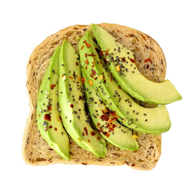 Open avocado sandwich with chia seeds isolated over white stock photo