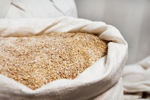 istock Open bag full grain malt 645648060