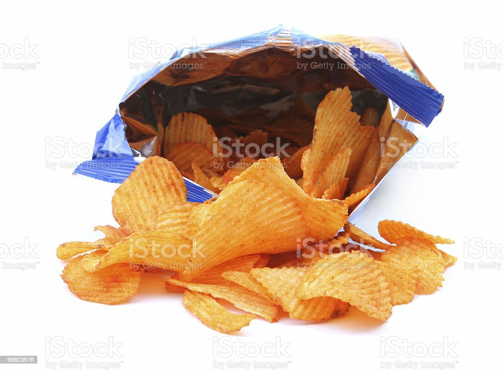 Open bag of potato chips spilling out royalty-free stock photo