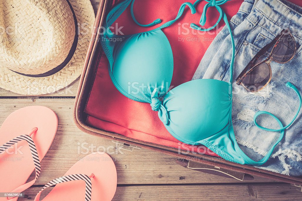 Open bag with beach or summer clothes stock photo