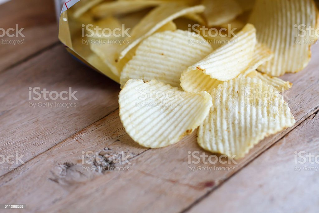 Open bag with potato chips stock photo