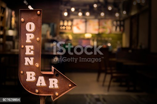 istock Open bar title signboard, in front of the bar 927629854