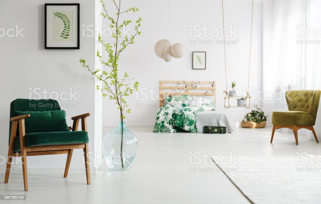 Open bedroom with green armchair stock photo