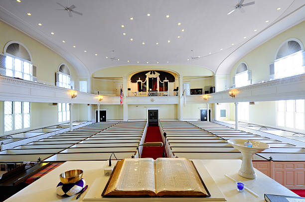 Open Bible, Church Interior Open bible on the pulpit. Church interior general view. pulpit stock pictures, royalty-free photos & images