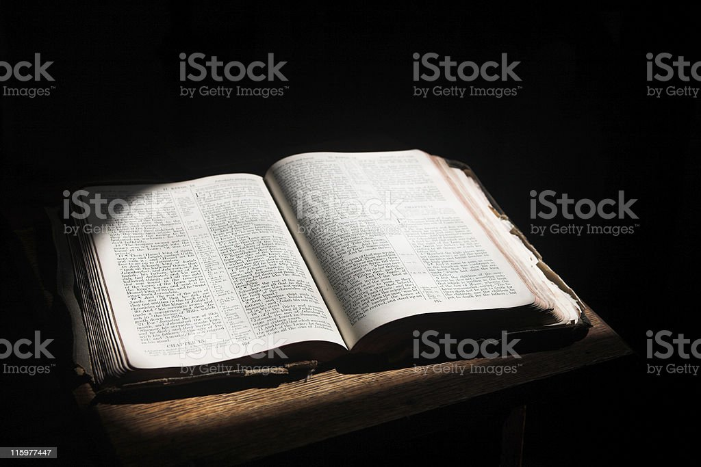 Open bible lying on a table stock photo