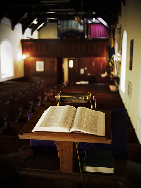 Open Bible on pulpit stock photo