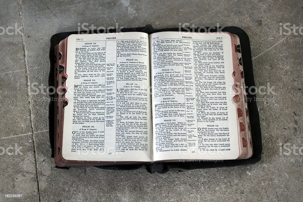 Open bible on stone - Psalms 128-136 stock photo