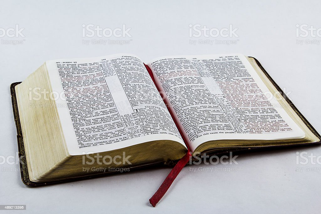 Open Bible on White Background stock photo