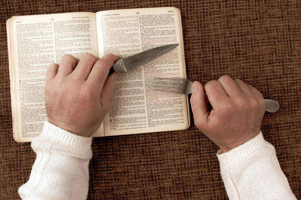 open bible spiritual food and drink. understanding Bible study as spiritual food for the soul stock photo