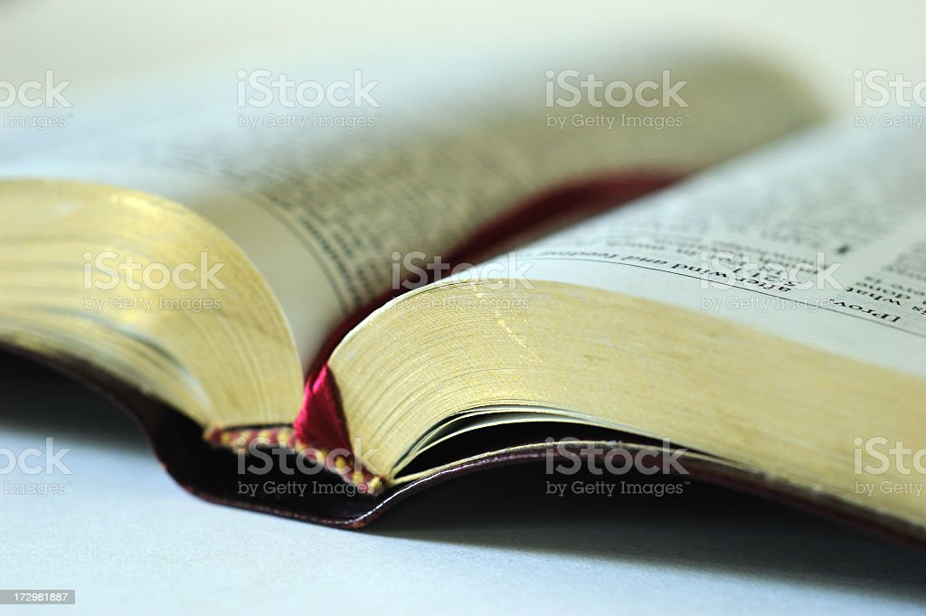 Open bible with a red bookmark inside stock photo