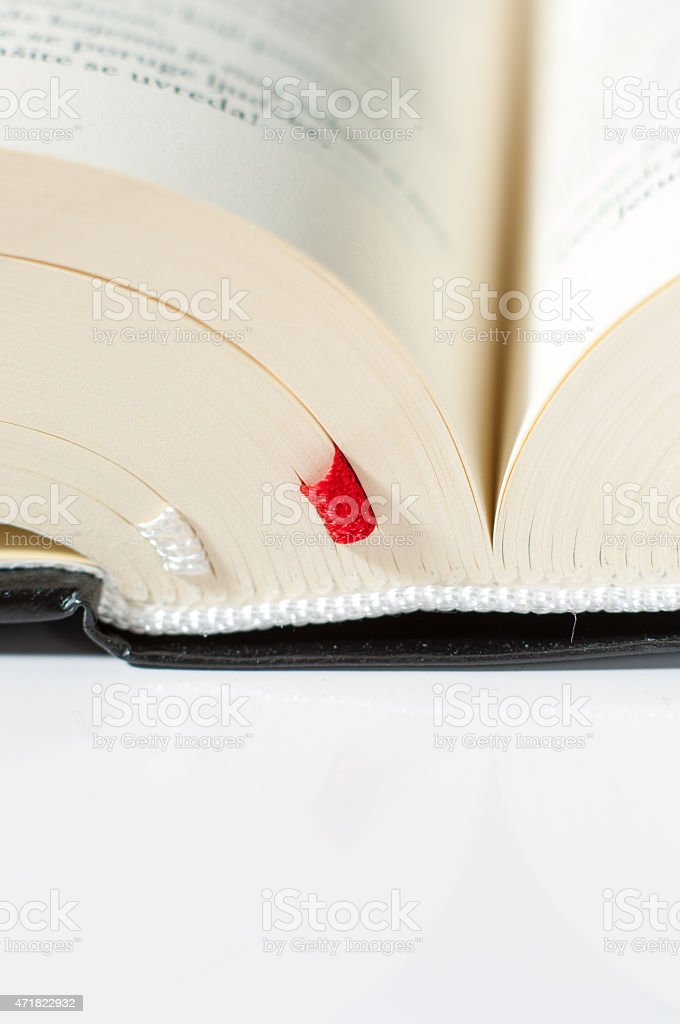 Open Bible with bookmarks stock photo