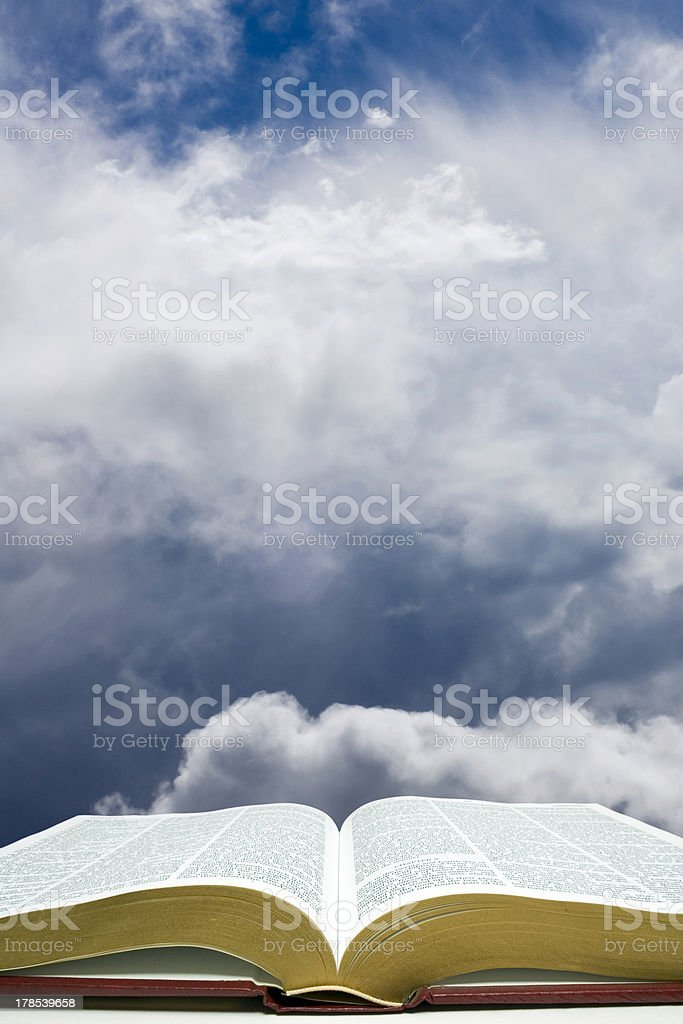 Open Bible with Creation Sky stock photo