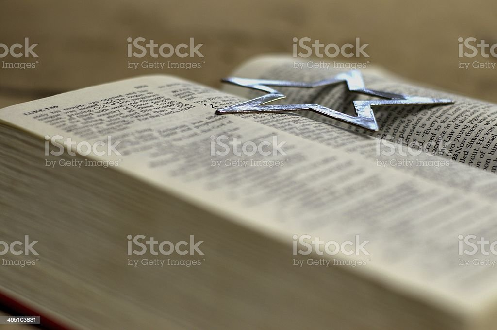 Open Bible with silver star stock photo