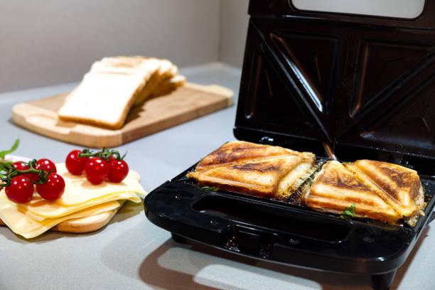 Open black sandwich maker stock photo