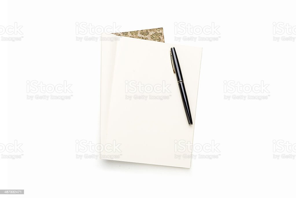 open blank book with black pen, isolated on white stock photo