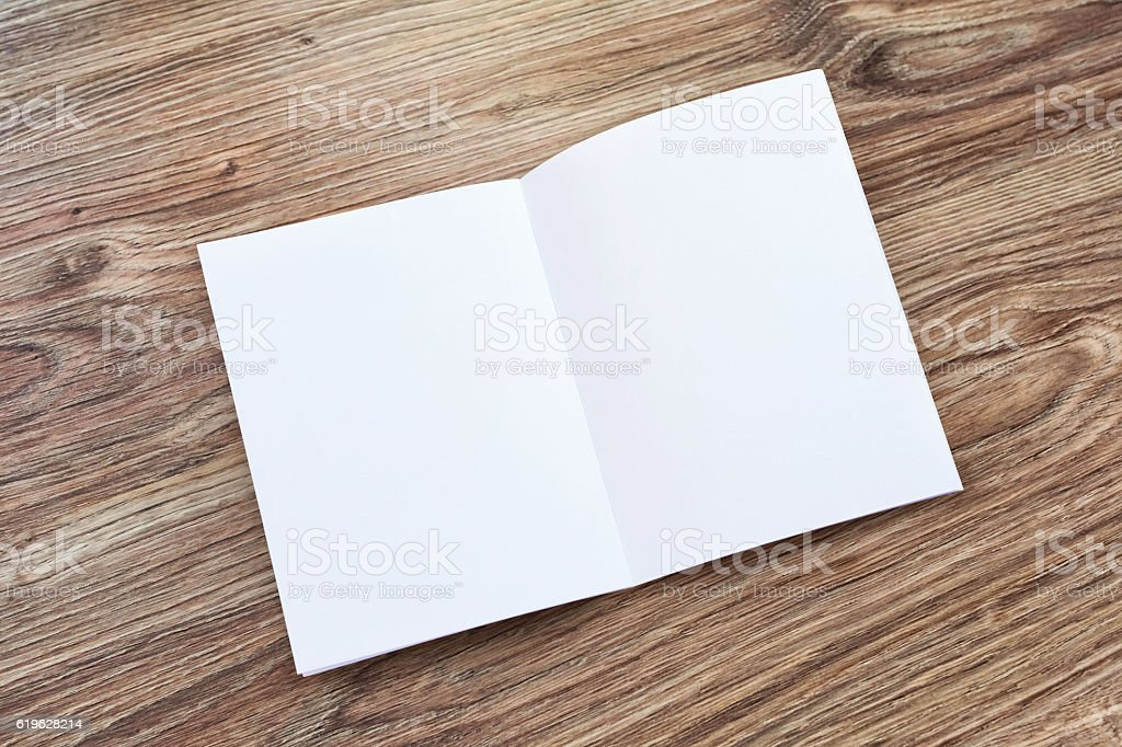 Open blank brochure, magazine is on a wooden desk stock photo