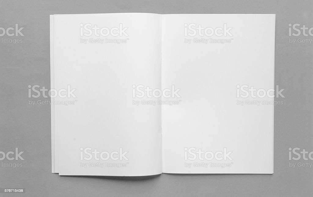 Open blank brochure with copy space on grey plain background stock photo