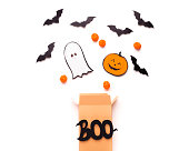 istock Open boo box with flying outside Candies, bats and ghosts 1179602391