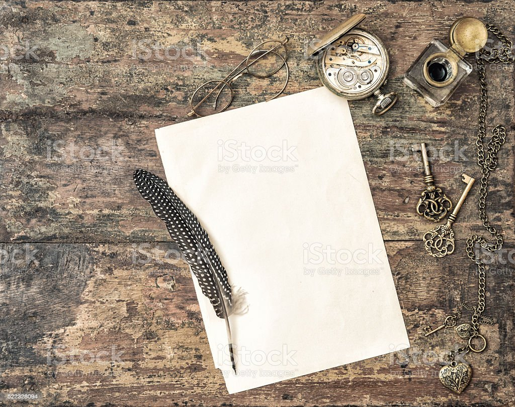 Open book and antique writing accessories vintage stock photo