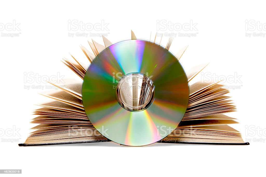 Open book and CD isolated on white - audiobook concept stock photo