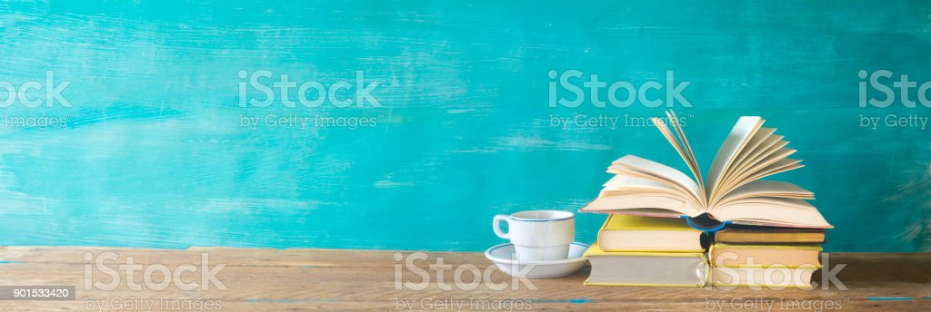 open book and cup of coffee cup stock photo