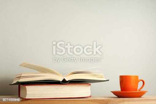 istock Open book and cup of coffee on wooden table. Education background. Back to school.Copy space for text. 927455946