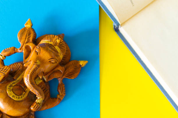 Open book and indian god ganesha