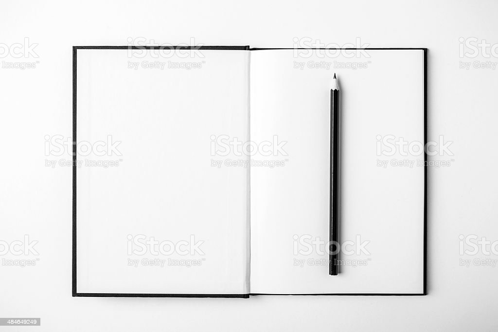 Open book and pencil on white desk. Copy space. stock photo