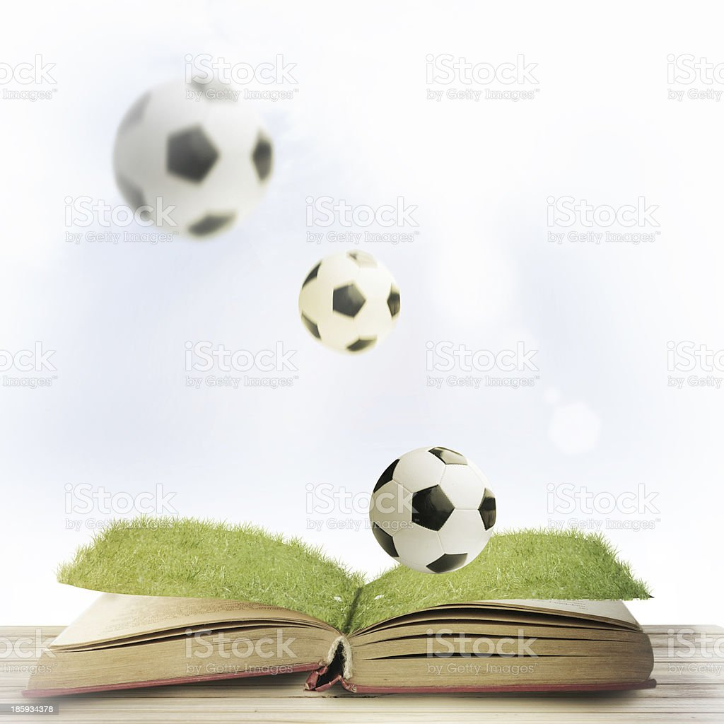 open book and soccer ball royalty-free stock photo