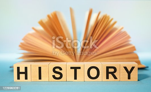 883154106 istock photo Open book and Wooden cubes with the abbreviation HISTORY 1226963281