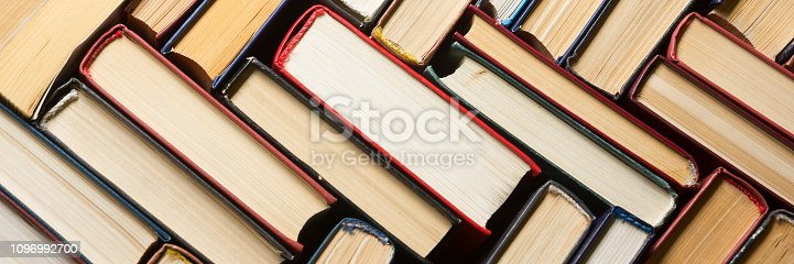 istock Open book, hardback books on wooden table. Back to school. Copy space. 1096992700