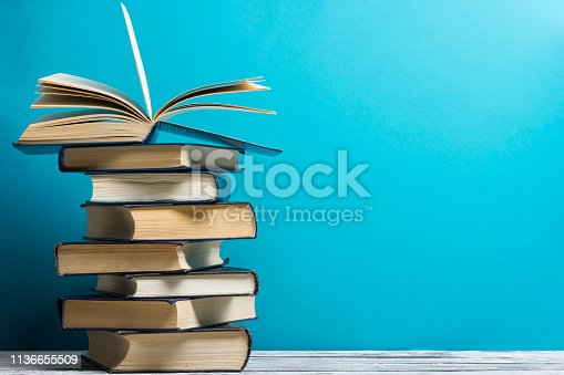 istock Open book, hardback books on wooden table. Back to school. Copy space. 1136655509