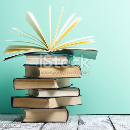 istock Open book, hardback books on wooden table. Back to school. Copy space 922579296