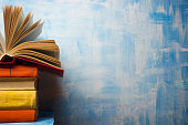 Open book, hardback books on wooden table. Back to school
