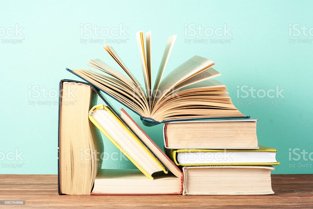 Open book, hardback books on wooden table. Education background. Back Стоковые фото Стоковая фотография
