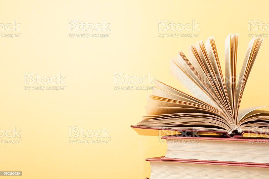 Open book, hardback books on wooden table. Education background. Back royaltyfri bildbanksbilder