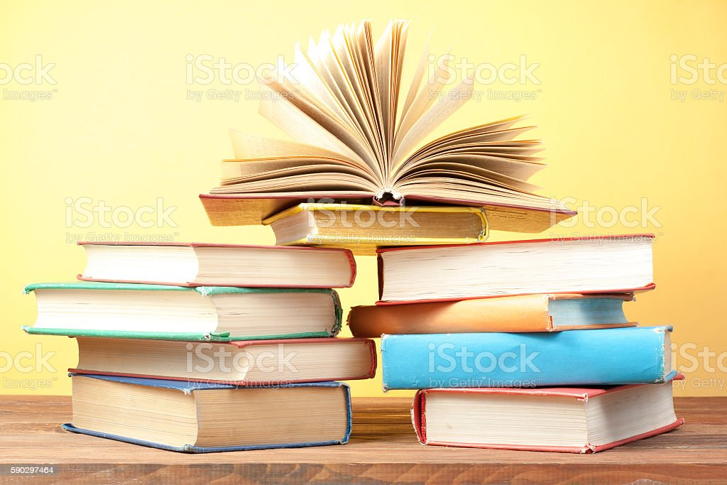 Open book, hardback books on wooden table. Education background. Back Стоковые фото Стоковая фотография