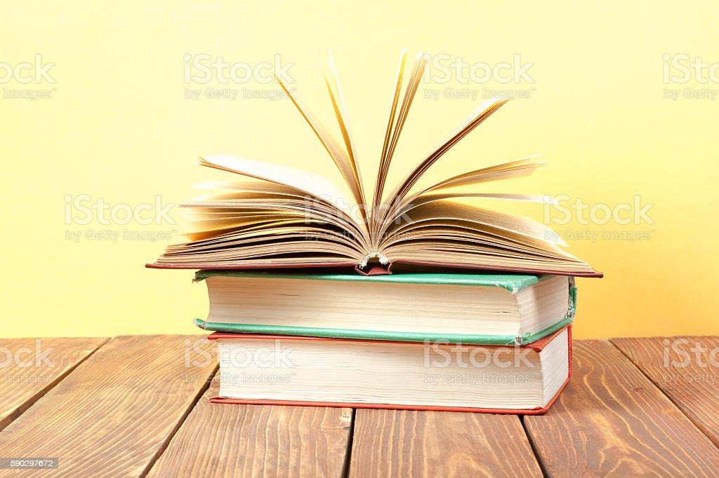 Open book, hardback books on wooden table. Education background. Back royaltyfri bildbanksbilder