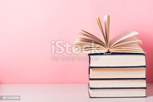istock Open book, hardback books on wooden table. Education background. Back 591809898