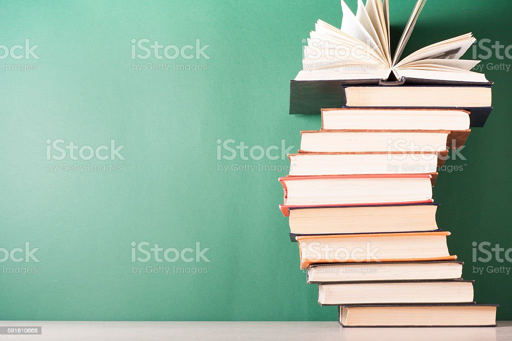 open book hardback books on wooden table education background back