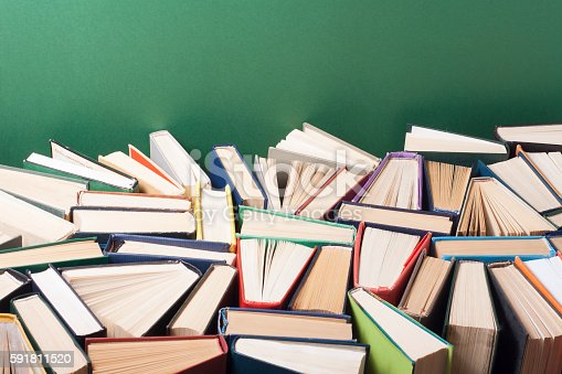 istock Open book, hardback books on wooden table. Education background. Back 591811520
